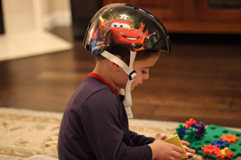 (James wearing his new helmet and playing with his new toys.)