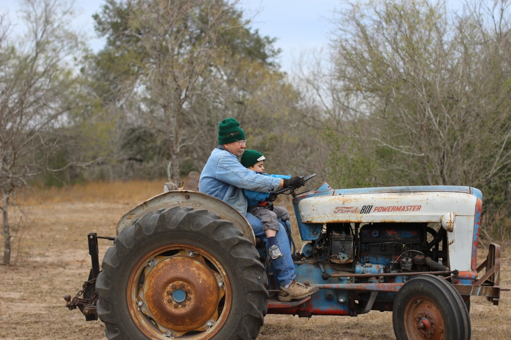 (James and Papa driving the tractor, the same one I used to drive with my grandpa.)