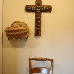 (Baskets and wood near the front door.)
