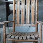 (An old rocking chair at the river house.)