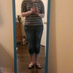 (A striped blouse with boyfriend jeans.)