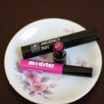 (Ardency Inn's Punker Unrivaled Volume & Curl Lash Wax, Modster Long Play Supercharged Lip Color in Circa Rose, and Modster Long Play Lip Vinyl in Club Remix.)