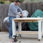 (Ryan sanding the newly built table.)