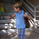 (Taking the stairs in the parking garage.  A big job for little legs.)