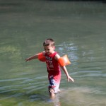 (James playing in the river.)