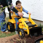 (James digging mulch with Papa.)