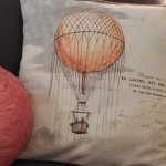 (My hot air balloon pillow cover by Jolie Marche via Etsy.)