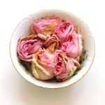 (Week-old roses in one of my favorite bowls.)