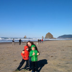 (Braving the cold at Haystack Rock in Cannon Beach.)